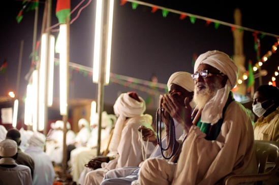Sufis sit during a recital of stories of the life of the Prophet Mohamed during Mawlid celebrations.