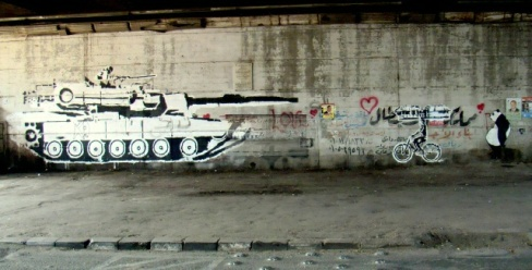Ganzeer tank versus bike work, under the October 6th Bridge. Copyright Suzee in the City.